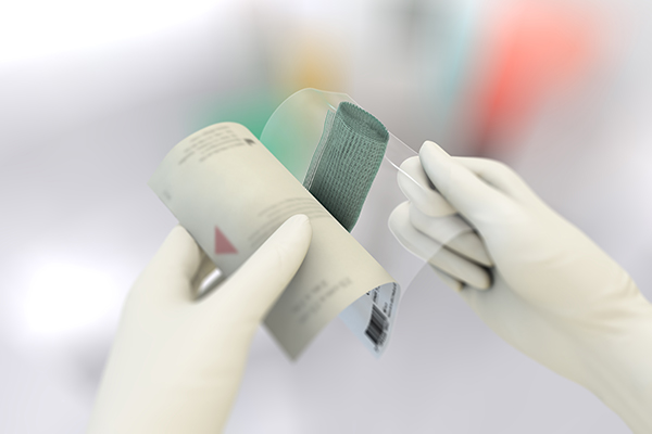 Two illustrated hands instructing how to open a Sorbact ribbon gauze package.